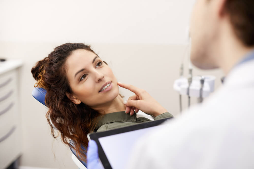 dentist checking female patient